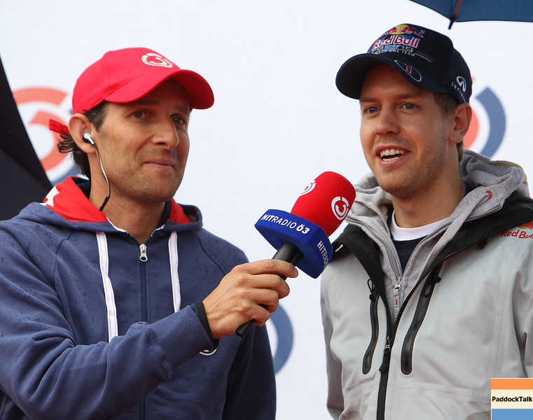 GEPA-15051181042 - SPIELBERG,AUSTRIA,15.MAY.11 - MOTORSPORT, FORMULA 1 - Open House Day Red Bull Ring, project Spielberg. Image shows Tom Walek (OE 3) and Sebastian Vettel (GER/ Red Bull Racing). Keywords: interview. Photo: GEPA pictures/ Christian Walgram - For editorial use only. Image is free of charge.