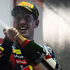 GEPA-25091199016 - FORMULA 1 - Grand Prix of Singapore. Image shows the rejoicing of Sebastian Vettel (GER/ Red Bull Racing). Keywords: sparkling wine, award ceremony.  Photo: Getty Images/ Ker Robertson - For editorial use only. Image is free of charge