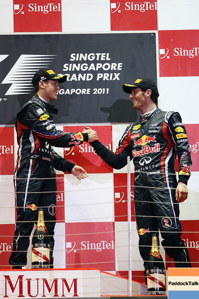 GEPA-25091199027 - FORMULA 1 - Grand Prix of Singapore. Image shows  the rejoicing of Sebastian Vettel (GER/ Red Bull Racing) amd Mark Webber (AUS/ Red Bull Racing).. Keywords: award ceremony, sparkling wine. Photo: Getty Images/ Mark Thompson - For editorial use only. Image is free of charge