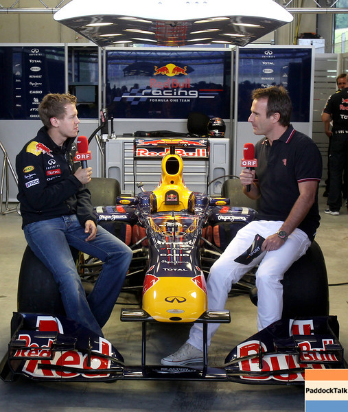 GEPA-14051181176 - SPIELBERG,AUSTRIA,14.MAY.11 - MOTORSPORT, FORMULA 1 - Media Day Red Bull Ring, project Spielberg. Image shows Sebastian Vettel (GER/ Red Bull Racing) and Ernst Hausleitner (ORF). Keywords: interview. Photo: GEPA pictures/ Christian Walgram - For editorial use only. Image is free of charge.