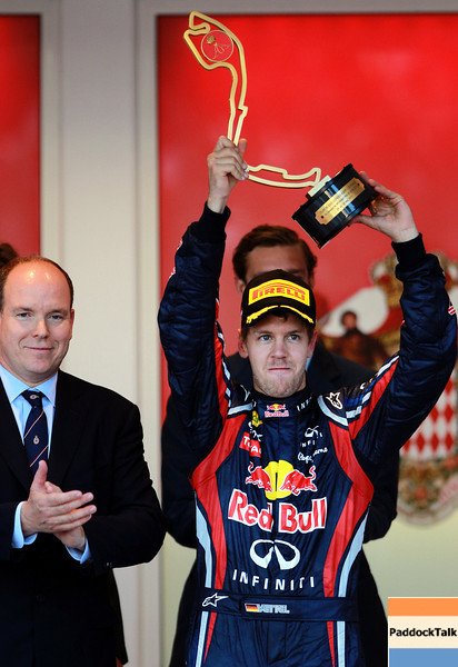 GEPA-29051199013 - FORMULA 1 - Grand Prix of Monaco. Image shows Sovereign Prince Albert of Monaco and the rejoicing of Sebastian Vettel (GER/ Red Bull Racing). Keywords: Podium, award ceremony, trophy. Photo: Paul Gilham/ Getty Images - For editorial use only. Image is free of charge