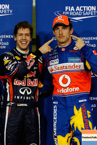 GEPA-12111199013 - FORMULA 1 - Grand Prix of Abu Dhabi, Yas Marina Circuit. Image shows Sebastian Vettel (GER/ Red Bull Racing) and Jenson Button (GBR/ McLaren Mercedes). Photo: Getty Images/ Paul Gilham - For editorial use only. Image is free of charge