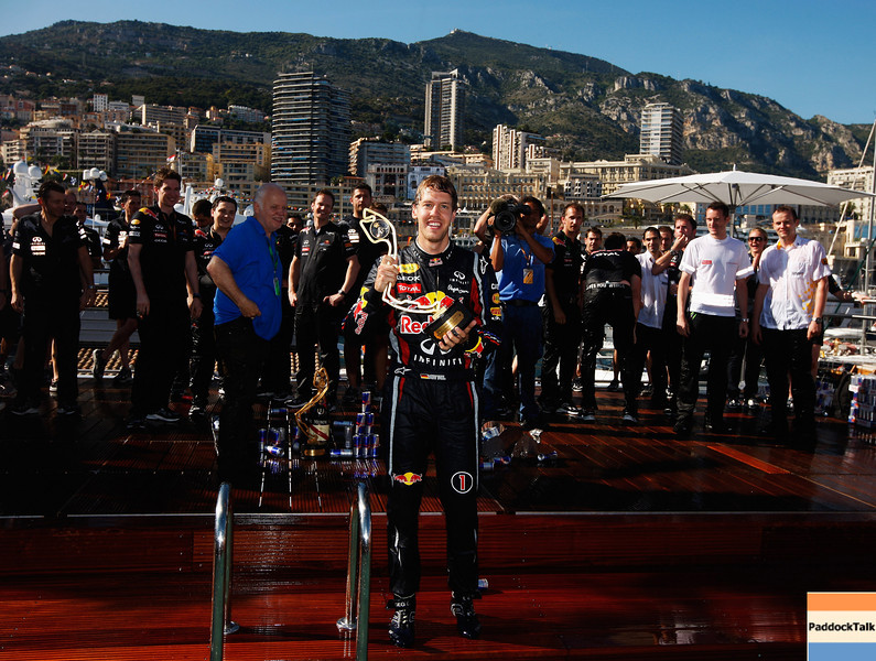 GEPA-29051199025 - FORMULA 1 - Grand Prix of Monaco. Image shows Sebastian Vettel (GER/ Red Bull Racing) celebrates with the winners trophy at the the Red Bull Racing Energy Station swimming pool. Photo: Mark Thompson/ Getty Images - For editorial use only. Image is free of charge