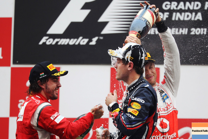 GEPA-30101199014 - FORMULA 1 - Grand Prix of India, Buddh-International-Circuit. Image shows Fernando Alonso (ESP/ Ferrari),  (Sebastian Vettel (GER/ Red Bull Racing) und Jenson Button (GBR/ McLaren Mercedes). Keywords: award ceremony,podium. Photo: Getty Images/ Mark Thompson - For editorial use only. Image is free of charge