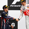 GEPA-12061199021 - FORMULA 1 - Grand Prix of Canada, award ceremony. Image shows Sebastian Vettel (GER/ Red Bull Racing) und Jenson Button (GBR/ McLaren Mercedes). Photo: Mark Thompson/ Getty Images - For editorial use only. Image is free of charge