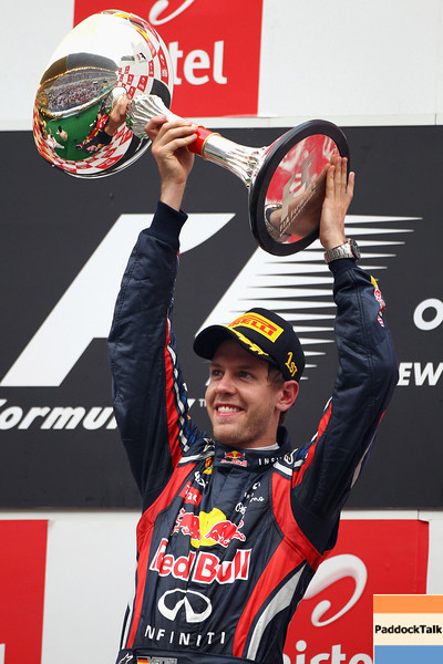 GEPA-30101199025 - FORMULA 1 - Grand Prix of India, Buddh-International-Circuit. Image shows the rejoicing of Sebastian Vettel (GER/ Red Bull Racing). Keywords: award ceremony, podium, trophy. Photo: Getty Images/ Clive Mason - For editorial use only. Image is free of charge