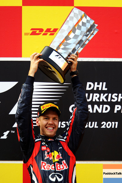 GEPA-08051199019 - FORMULA 1 - Grand Prix of Turkey. Image shows the rejoicing of Sebastian Vettel (GER/ Red Bull Racing). Keywords: podium, award ceremony, trophy. Photo: Mark Thompson/ Getty Images - For editorial use only. Image is free of charge