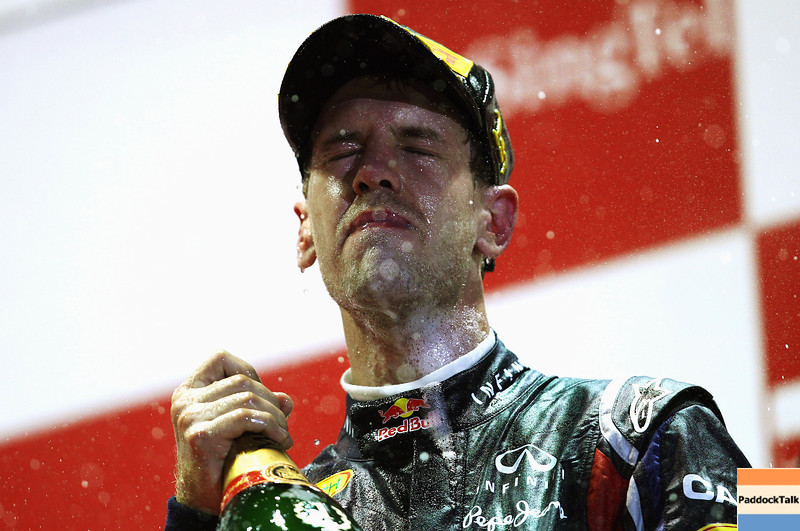 GEPA-25091199012 - FORMULA 1 - Grand Prix of Singapore. Image shows the rejoicing of Sebastian Vettel (GER/ Red Bull Racing). Keywords: sparkling wine, award ceremony. Photo: Getty Images/ Vladimir Rys - For editorial use only. Image is free of charge