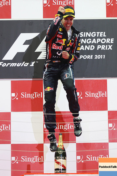 GEPA-25091199021 - FORMULA 1 - Grand Prix of Singapore. Image shows the rejoicing of Sebastian Vettel (GER/ Red Bull Racing). Keywords: sparkling wine, award ceremony. Photo: Getty Images/ Mark Thompson - For editorial use only. Image is free of charge