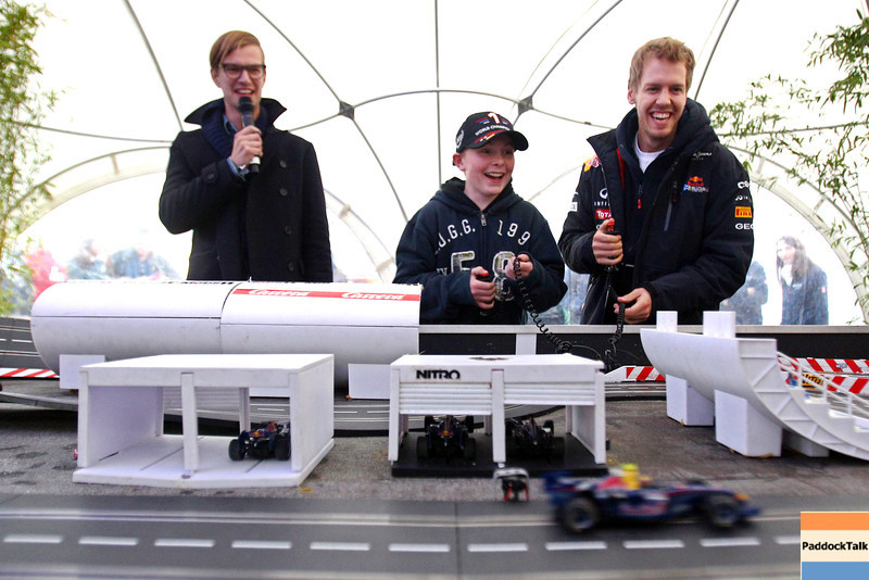 GEPA-22101199502 - FORMULA 1 - World Championship Party. Image shows Sebastian Vettel (GER/ Red Bull Racing) and a kid. Photo: Getty Images/ Alex Grimm - For editorial use only. Image is free of charge