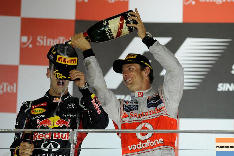 SINGAPORE GRAND PRIX F1/2012 - SINGAPORE 23/09/2012 - SEBASTIAN VETTEL and JENSON BUTTON