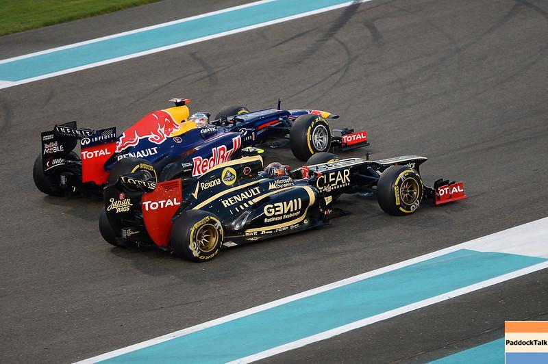 ABU DHABI GRAND PRIX F1/2012 - YAS MARINA 04/11/2012 - SEBASTIAN VETTEL AND ROMAIN GROSJEAN.