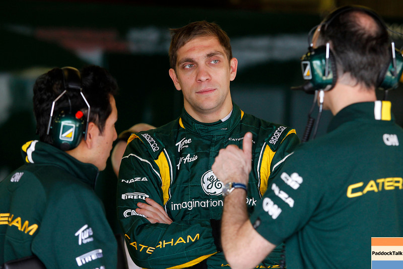 2012 Formula One Barcelona Test Day One<br /> Circuit de Catalunya, Barcelona, Spain<br /> 1st March 2012<br /> Vitaly Petrov, Caterham F1 Team listening to a Caterham F1 Team engineer.<br /> World Copyright: Andrew Ferraro/LAT Photographic<br /> ref: Digital Image _Q0C4372<br /> Courtesy of Caterham