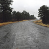 Kristin Molinaro<br /> Improvment and road widening on a portion of Midwest Road is nearly complete. The road, once a dirt trail, will receive one more layer of 6-inch thick granular aggregate base,