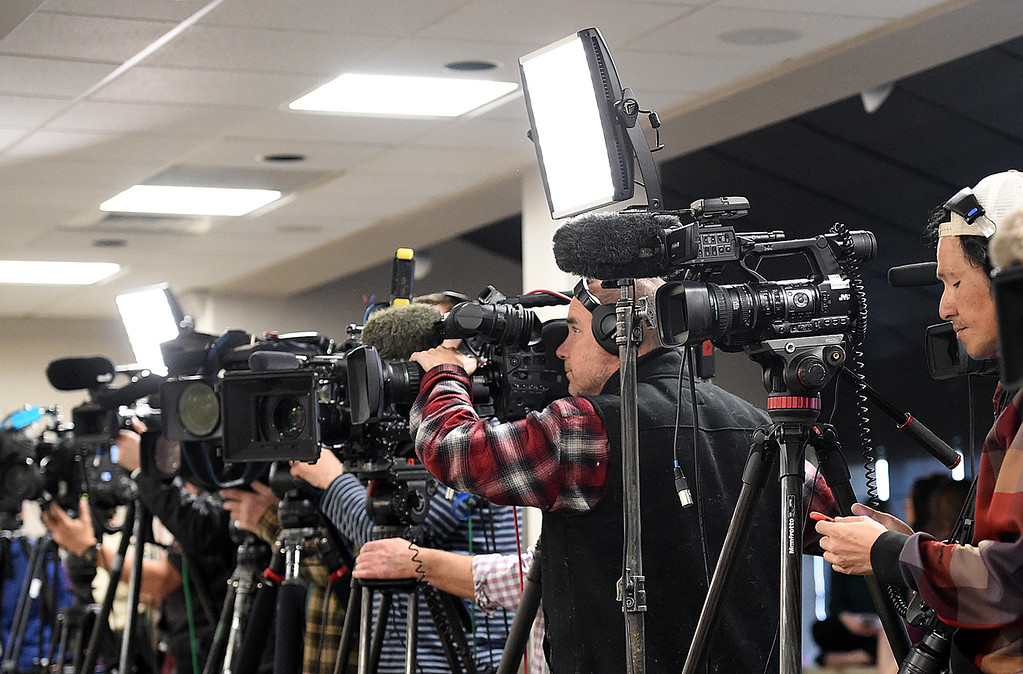 . Members of the media listen and film as Travis Kauffman explains Thursday, Feb. 14, 2019, about how a mountain lion attacked him and how he fought back and killed the animal even though his right hand was locked in the lion\'s jaw.  (Photo by Jenny Sparks/Loveland Reporter-Herald)
