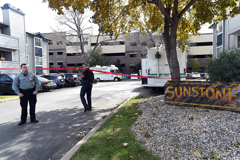 Police tapes blocks off a parking lot as Fort Collins Police investigate a shooting Thursday, Oct. 19, 2017, at the Sunstone Apartments, 720 City Park Ave., in Fort Collins. Fort Collins Police confirm that three people died and one was injured in the early morning shooting.  (Photo by Jenny Sparks/Loveland Reporter-Herald)