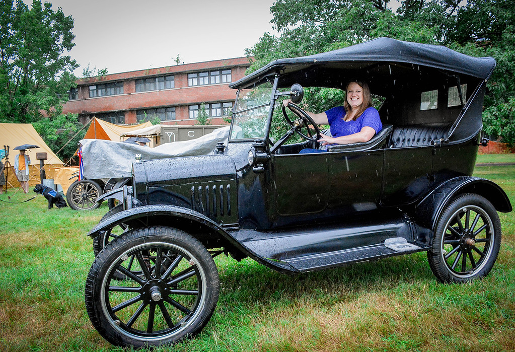 . Director of the museum, Kara Fossey takes a seat in one of the 1920\'s cars displayed at the 100th Anniversary of Fort Devens. SUN/Caley McGuane