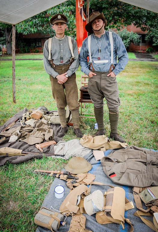 . From left, Brenden LaFeur of Laconia and Dave Laiche of Nashua dress the part and display items such as clothing and weapons used during the war. SUN/Caley McGuane