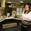 Standing amongst one of the displays at the Fort Devens Museum Director Kara Fossey talks about the museum and its up coming open house. SUN/JOHN LOVE