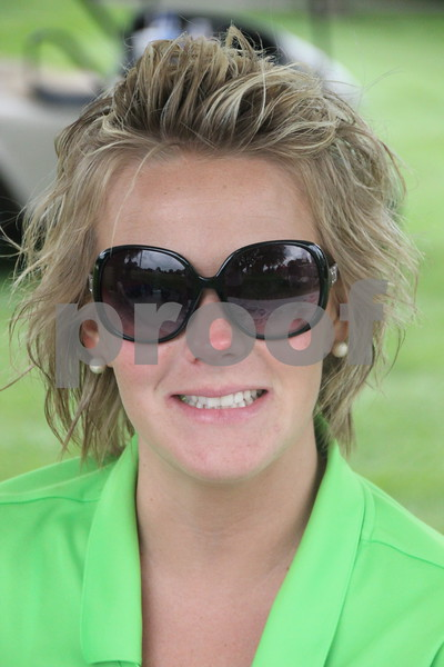 Jalon Keigher was one of the volunteers helping out at the Fort Dodge Chamber of Commerce Golf Outing  held at the Fort Dodge Country Club on Thursday, August 6, 2015.