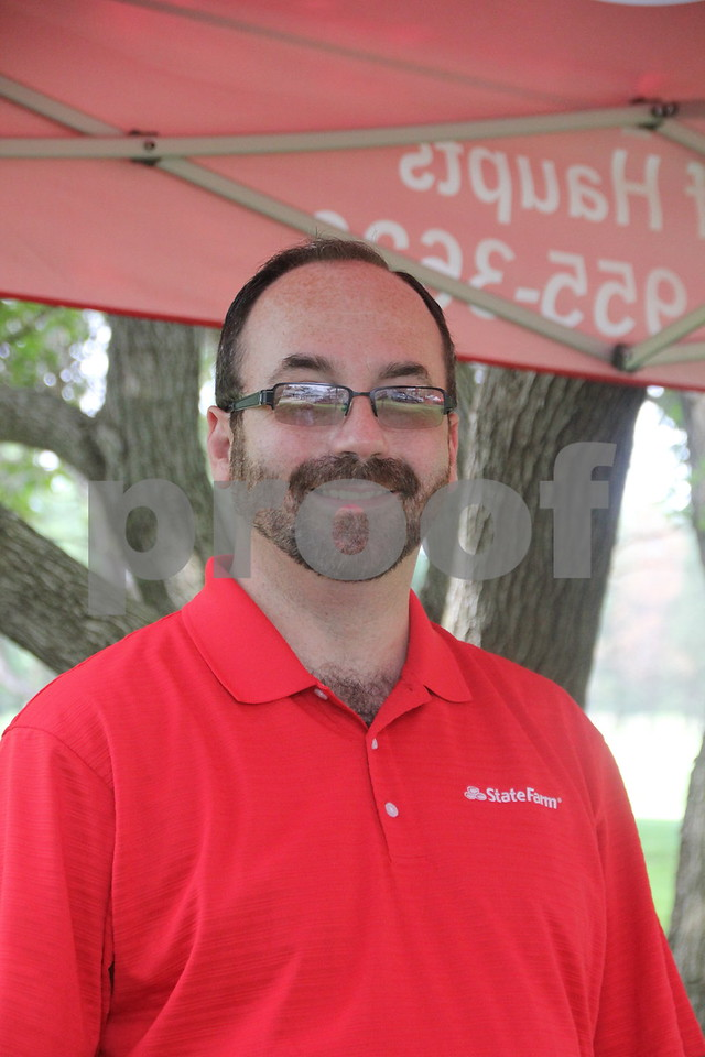 Mark Sharpe from State Farm was one of those who provided items like towels, beverage cups, etc. to the golfers at the Fort Dodge Chamber of Commerce Golf Outing on Thursday, August 6, 2015 at the Fort Dodge Country Club.