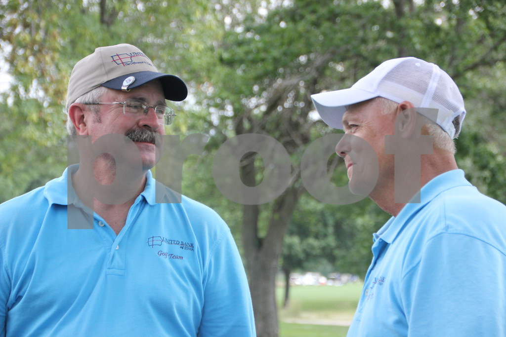 Seen here is (left to right): Rich Bahls, and Duane Handlos chatting  while they await their turn to tee off at the Fort Dodge Country Club's Fort Dodge Chamber of Commerce Golf Outing event  on Thursday, August 6, 2015.