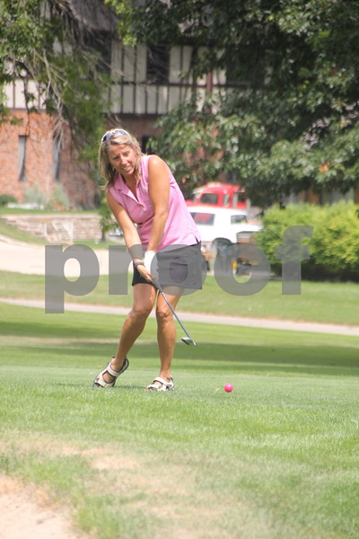 Brenda Eckard takes her shot in the Fort Dodge Chamber of Commerce Golf Outing event held at the fort Dodge Country Club on Thursday, August 6, 2015.