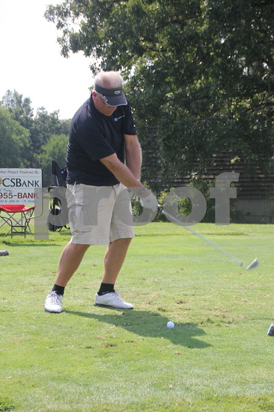 Dr Jim Meyer takes some practice swings before teeing off. He got his  first ever hole in one on hole # 8. He was a participant in the Chamber of Commerce Golf Outing on Thursday, August 6, 2015 , that took place at the Fort Dodge Country Club.