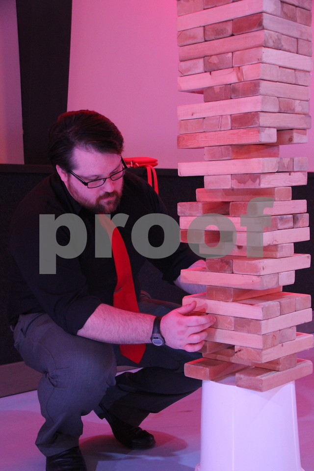 Saturday, April 9, 2016, the Fort Dodge Community School Foundation Dinner was held at Fort Frenzy in Fort Dodge. Pictured here is: Merve Casey as he plays Jenga. Jenga was just one of many games provided at the event.