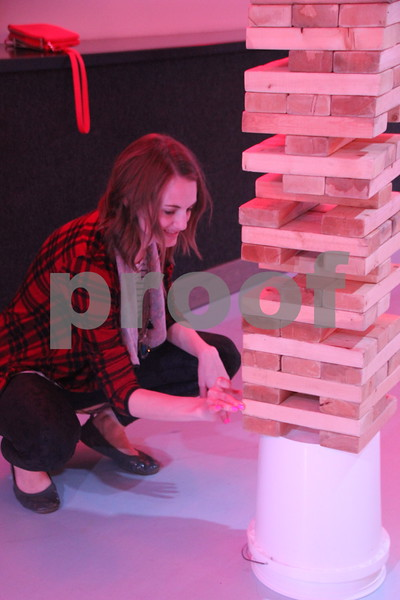 Saturday, April 9, 2016, the Fort Dodge Community School Foundation Dinner was held at Fort Frenzy in Fort Dodge. Pictured here is: Catherine Casey as she plays Jenga. Jenga was just one of many games provided at the event.