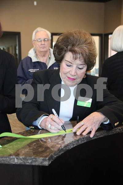 Thursday, February 18, 2016, Fort Dodge Family Credit Union in Fort Dodge had their ribbon cutting ceremony. Seen here is : Earlene Nordstrom signing the ribbon after the ceremony.