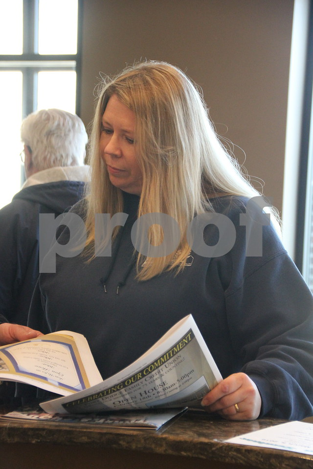Seen here is Lorrie Grady after the ribbon cutting ceremony, held on Thursday, February 18, 2016, for the Fort Dodge Family Credit Union in Fort Dodge.