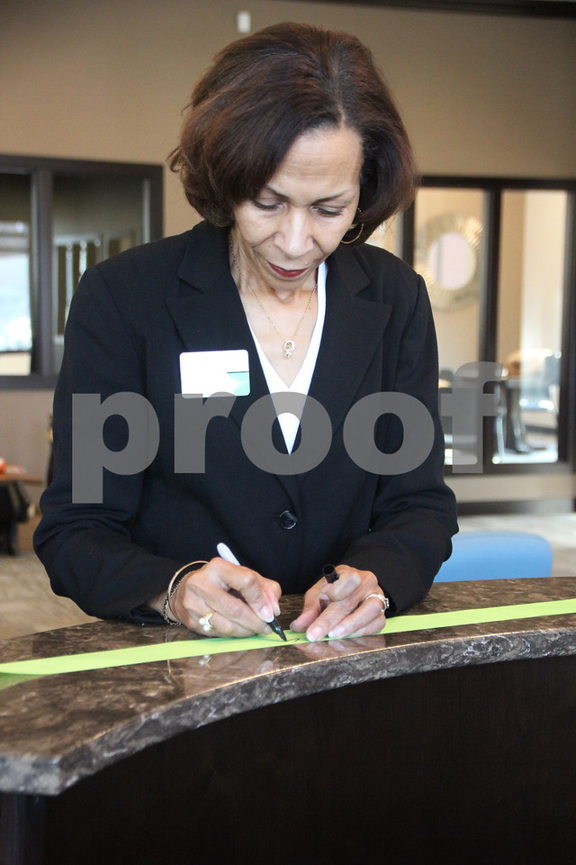 Thursday, February 18, 2016, Fort Dodge Family Credit Union in Fort Dodge had their ribbon cutting ceremony. Seen here is : Clarice Thompson as she signs the ribbon  after the ceremony.