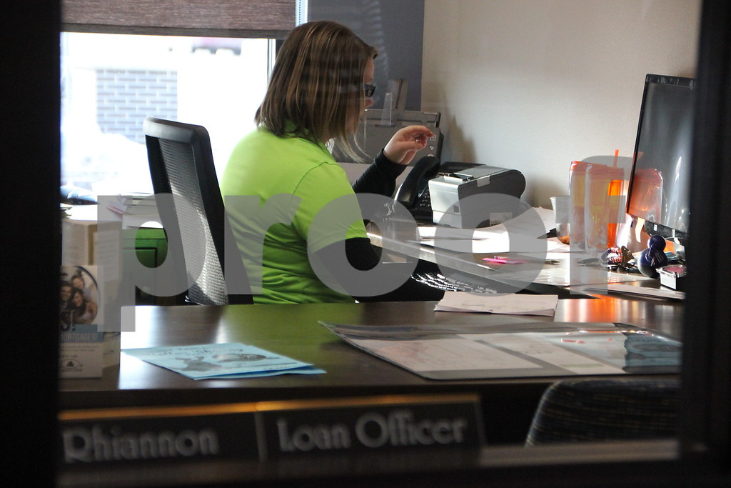 Seen here is: Rhiannon Patterson  at her desk in her loan office after the ribbon cutting ceremony, held on Thursday, February 18, 2016, for the Fort Dodge Family Credit Union in Fort Dodge.