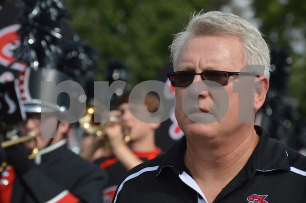 Fort Dodge Senior High band director Al Paulson accompanies the march through the city.