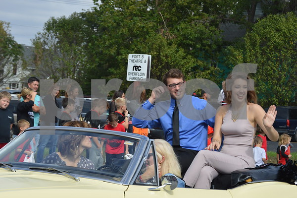 Former FDSH Homecoming king & queen Nick Sanford and Bekah Henkelman wave to parade-goers.