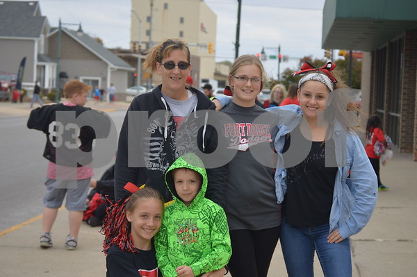 Anne Fliehe, Brianna & Jasmine Baguhn, Kayla Hannover, and Duane Fliehe pose for a photo outside the Fort 8 Theater.