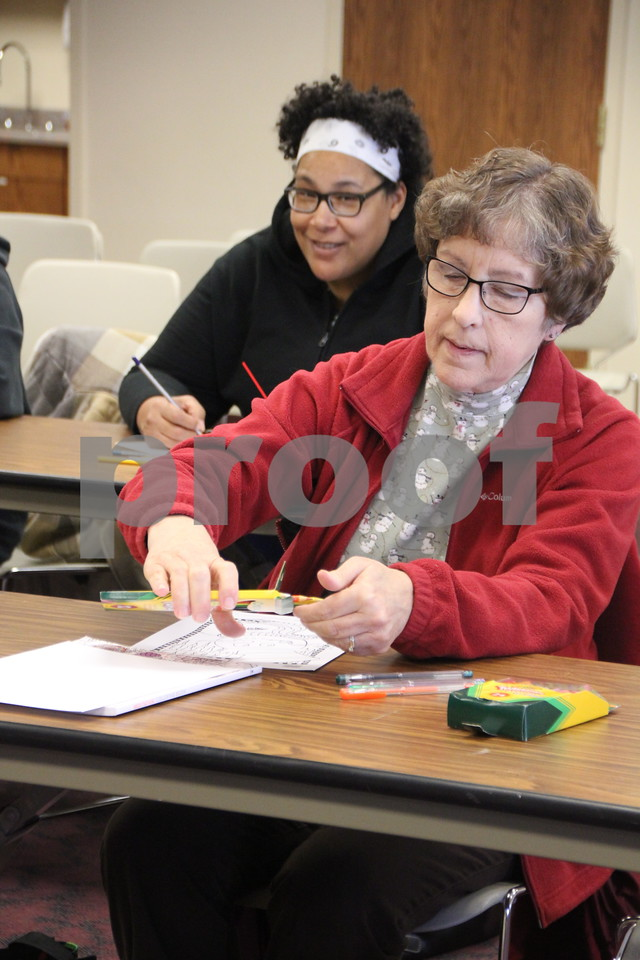 """There was a recent event that took place at the Fort Dodge Library, on Tuesday, January 12, 2016. It was called """"Coloring Your World"""" and was an adult coloring event complete with snacks and music. The library supplied most all the coloring supplies you would ever need along with coloring book pictures. A few other participants who took part are  pictured here (left to right): Wednesday Green and Holly Vogt."""
