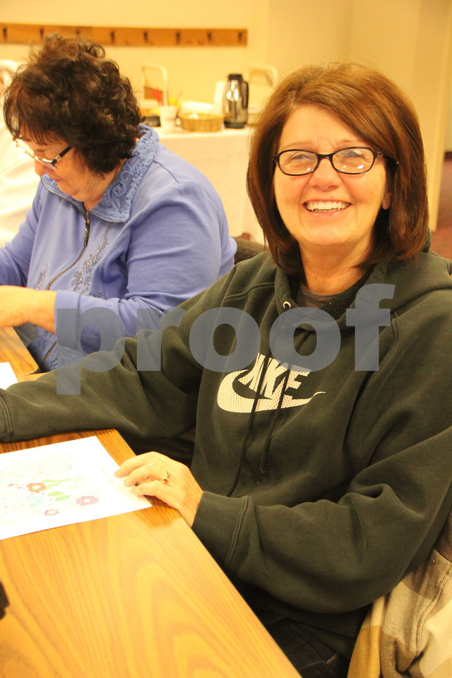 """There was a recent event that took place at the Fort Dodge Library, on Tuesday, January 12, 2016. It was called """"Coloring Your World"""" and was an adult coloring event complete with snacks and music. The library supplied most all the coloring supplies you would ever need along with coloring book pictures. Seen here is: Kathy Porrez, who was also a participant."""