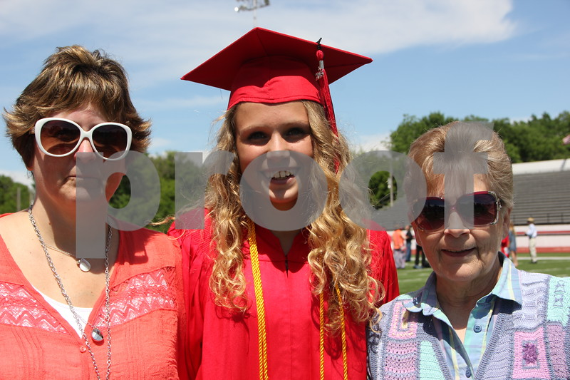 Show are left to right: Tracey Richardson, Hailee Richardson, and  Pam Pergande who stopped for a photo after the graduation held at Dodger Stadium for Fort Dodge Senior High on May 31, 2015