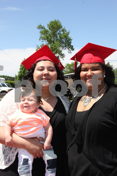 These  young ladies posed for a photo  after graduation for Fort Dodge Senior High students was over. Graduation took place at Dodger Stadium  on May 31, 2015. They are left to right: (baby) Ezmeralda Posekany, Alondra Zavala, and Teyera Johnson.