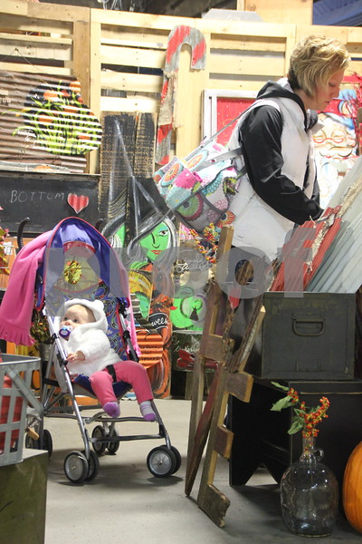 The place to be if you enjoy vintage and re-purposed things was the Vintage Market, which took place at the East Campus of Iowa Central Community College on Saturday, October 17, 2015. Pictured from left to right are: Ruby Lindner (baby) and Mallory Lindner.