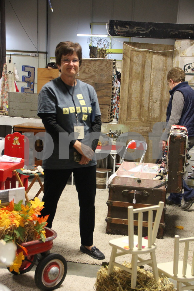 The place to be if you enjoy vintage and re-purposed things was the Vintage Market, which took place at the East Campus of Iowa Central Community College  on Saturday, October 17, 2015.  One of the people (seen here) who had a booth  at the event is : Lana Pratt.