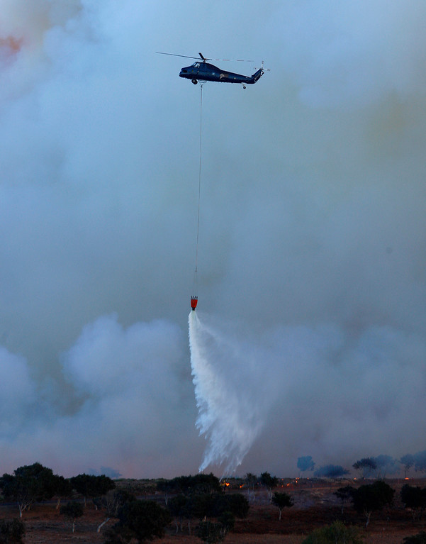 . A large water dropping helicopter was being used to cool the fire at the site of the Fort Ord prescribed burn on Thursday, Oct. 5, 2017.  Unit B of 265 acres and Unit C of a 145 acres were successfully burned.  (Vern Fisher - Monterey Herald)