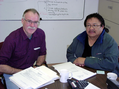 Dr. Andy Fyon (Director, Ontario Geological Survey) and Chief Charlie Okeese prepare to sign the communication agreement between Eabametoong First Nation and MNDM.