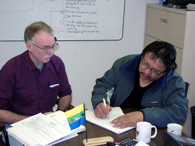 Dr. Andy Fyon (Director, Ontario Geological Survey) and Chief Charlie Okeese sign the communication agreement between Eabametoong First Nation and MNDM.