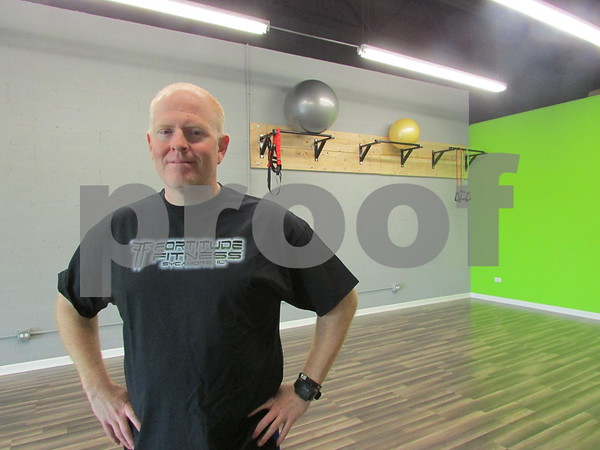 Mike Davis, owner of Fortitude Fitness, stands in the gym Friday at 265 W. Peace Road in Sycamore. The gym opened in August and offers a series of boot camp and fitness classes.