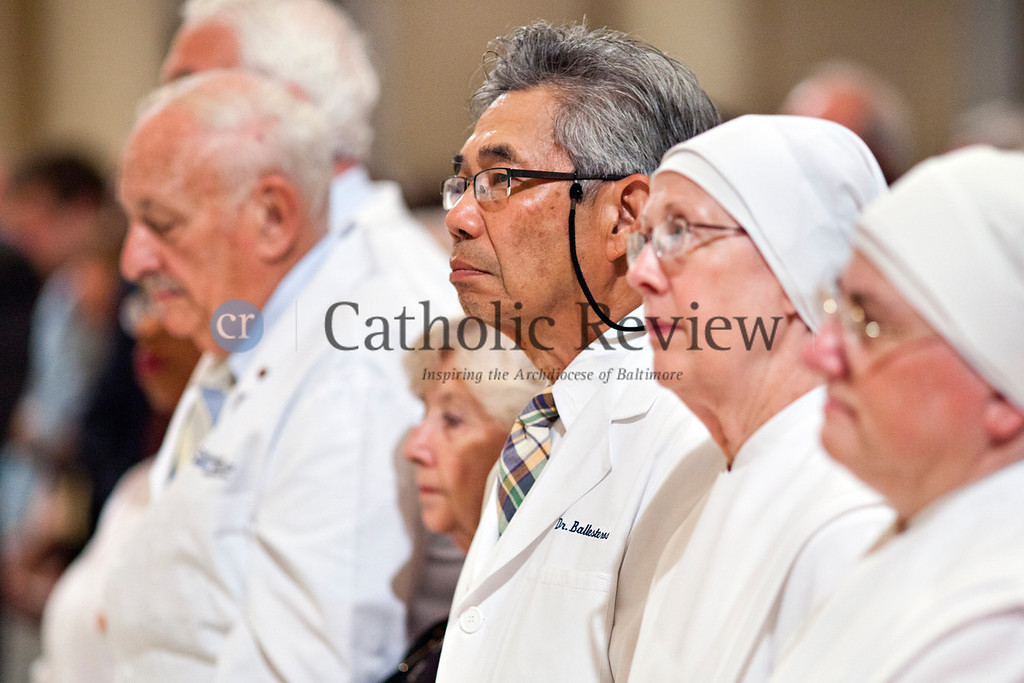 Dr. Rubin Ballesteros joined other members of the medical community in donning his white jacket at the Opening Mass for the Fortnight for Freedom at the Basilica of the National Shrine of the Assumption of the Blessed Virgin Mary in Baltimore June 21. (Tom McCarthy Jr. | CR Staff)