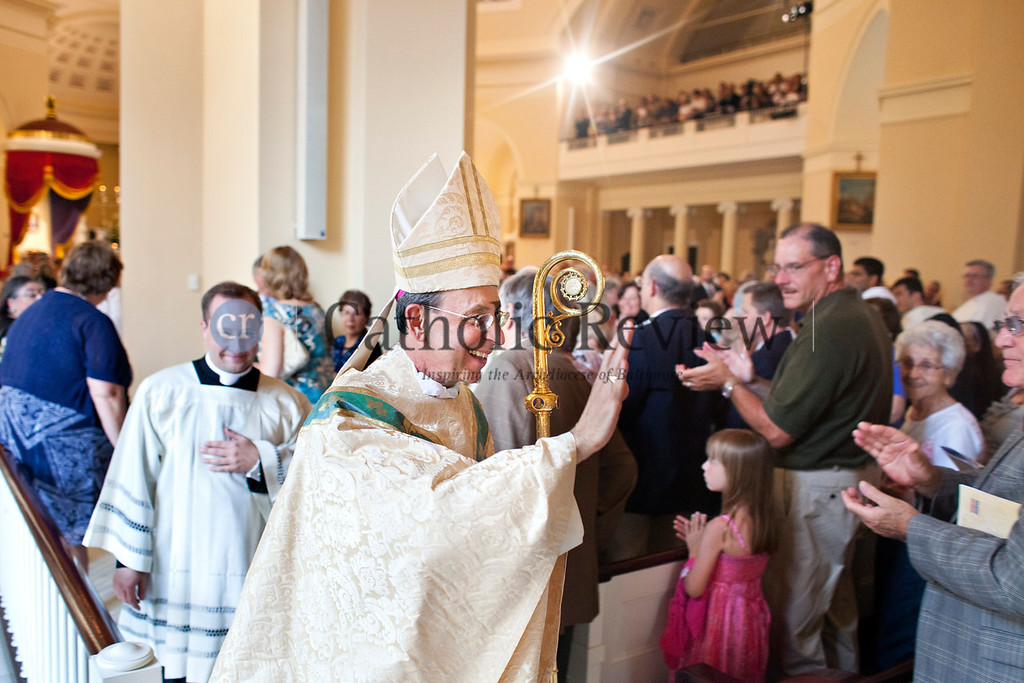 Archbishop William E. Lori receives an ovation upon exiting the sacristy before the start of the Opening Mass for the Fortnight for Freedom at the Basilica of the National Shrine of the Assumption of the Blessed Virgin Mary in Baltimore June 21. (Tom McCarthy Jr. | CR Staff)