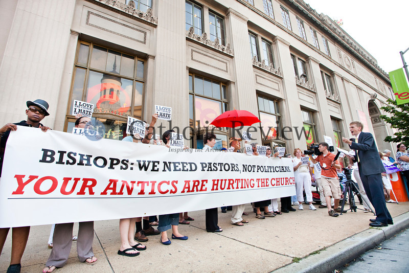Protesters organized by Catholics United stand across the street from the Basilica of the National Shrine of the Assumption of the Blessed Virgin Mary in Baltimore during the Opening Mass for the Fortnight for Freedom June 21. (Tom McCarthy Jr. | CR Staff)